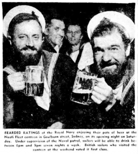 Wednesday, 14th Feburary 1945. The caption reads: BEARDED RATINGS of the Royal Navy enjoying their pots of beer at the Naafi Fleet canteen in Goulburn street, Sydney, on its opening night on Saturday. Under supervision of the Naval patrol, sailors will be able to drink between 6pm and 9pm seven nights a week. British sailors who visited the canteen at the weekend voted it first class. The man on the left is AB (LTO) Walter May and a one-badge Leading Seaman, presumably also from HMS Wager, is on the right.